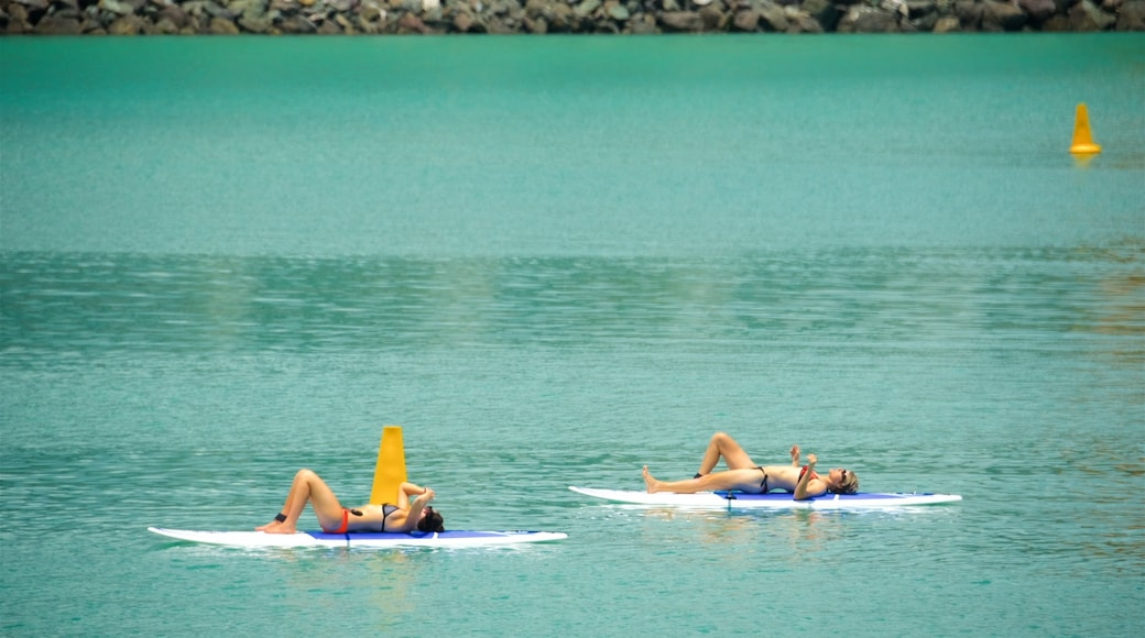 Airlie Beach featuring general coastal views and water sports as well as a couple