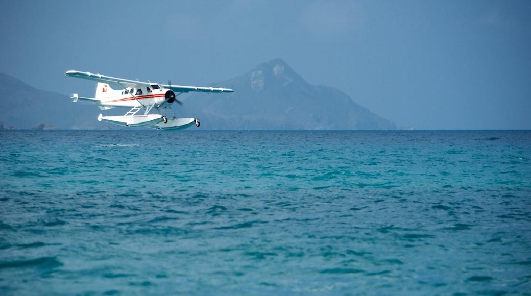 Hamilton Island featuring aircraft and general coastal views