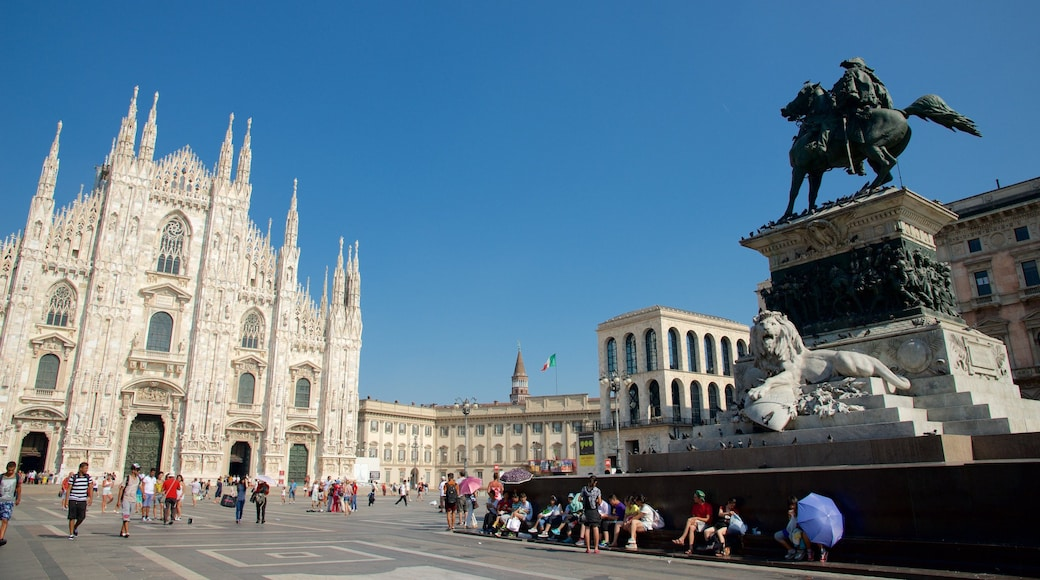 Piazza del Duomo featuring a statue or sculpture, street scenes and a square or plaza