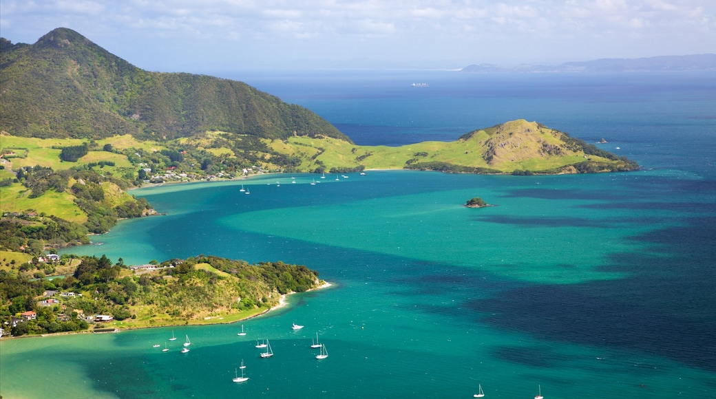 Mount Manaia featuring mountains, a bay or harbour and a coastal town