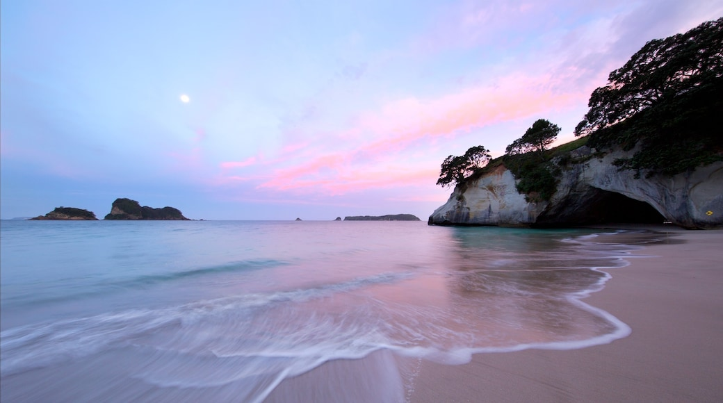 Waikato which includes rocky coastline, a sunset and a bay or harbour