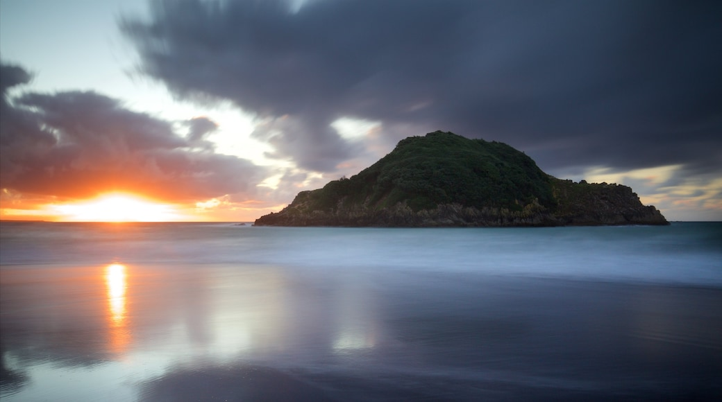 New Plymouth which includes a sunset, a bay or harbour and island images