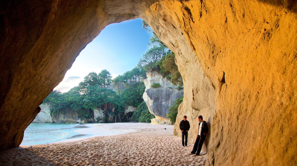 Cathedral Cove Beach which includes a bay or harbour, a beach and rugged coastline