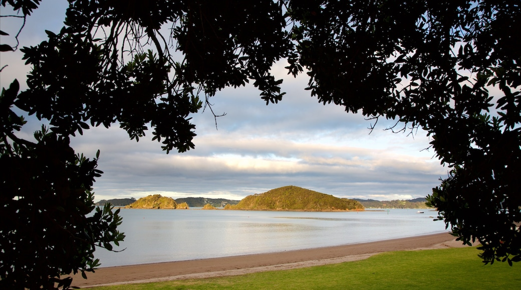 Paihia Beach which includes a bay or harbour, a sunset and a beach