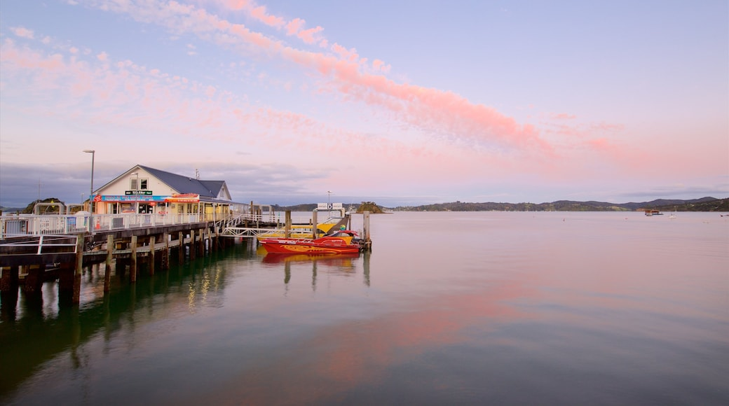 Paihia showing a sunset and a bay or harbour