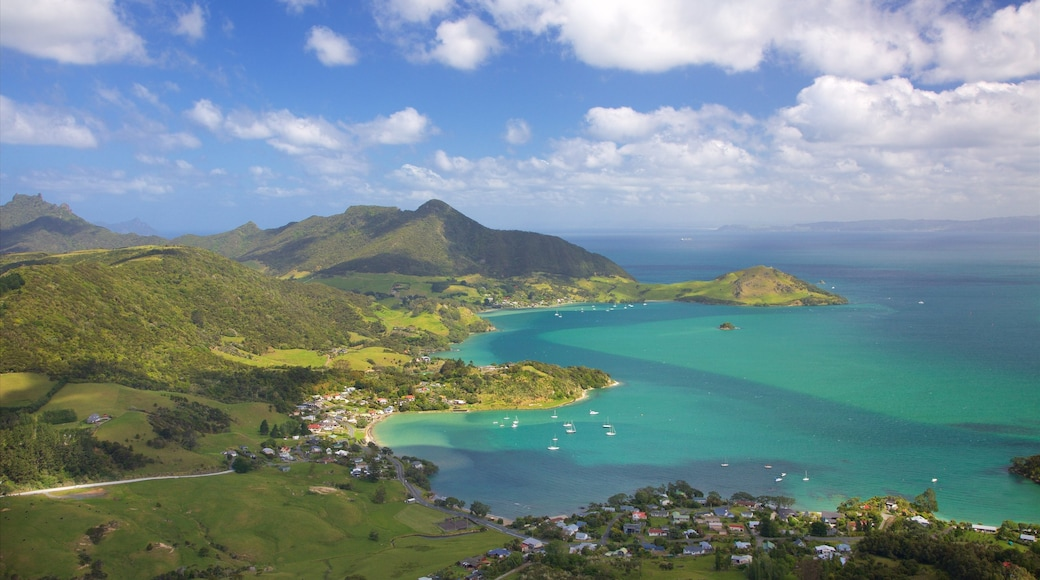 Mount Manaia showing a coastal town, a bay or harbour and mountains