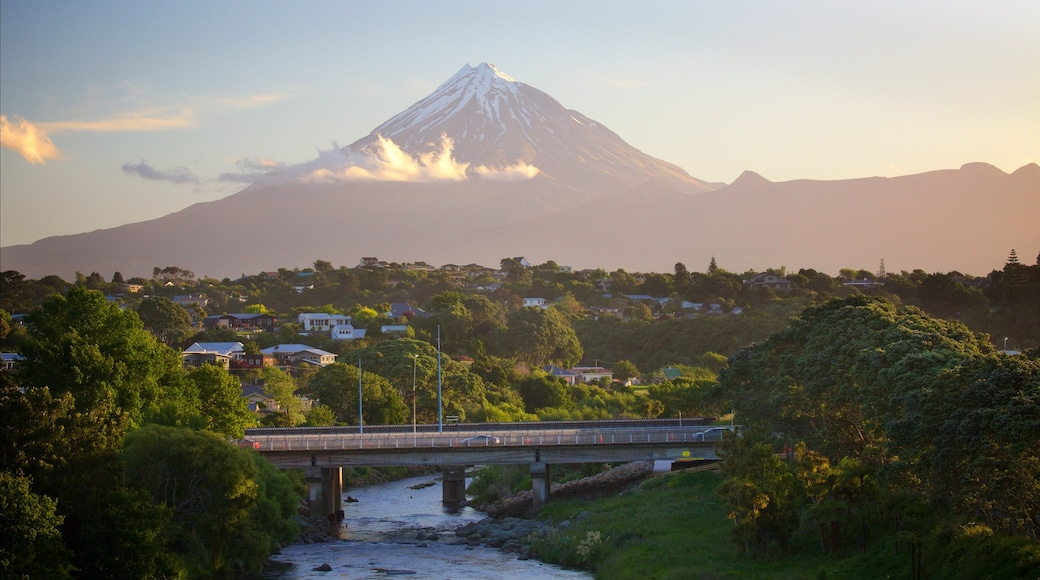 New Plymouth featuring a bridge, a river or creek and mountains