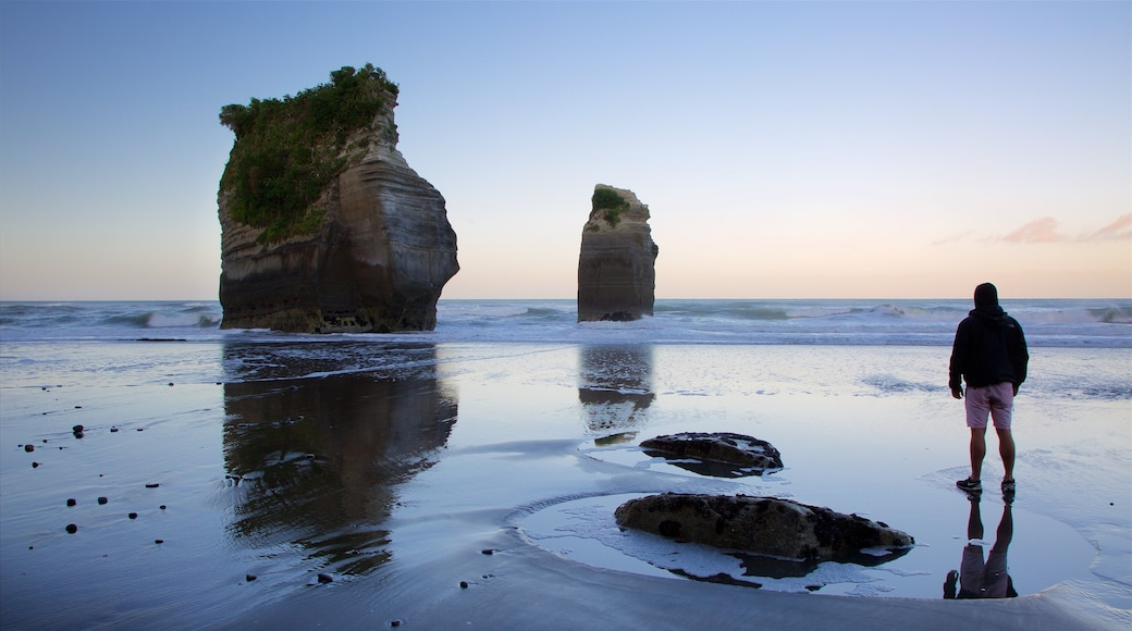 Tongaporutu showing rocky coastline, a sunset and a bay or harbour