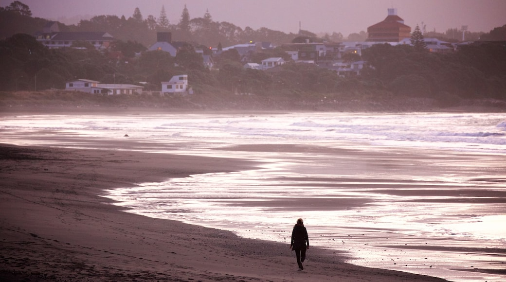 Fitzroy Beach featuring waves, a coastal town and a sunset