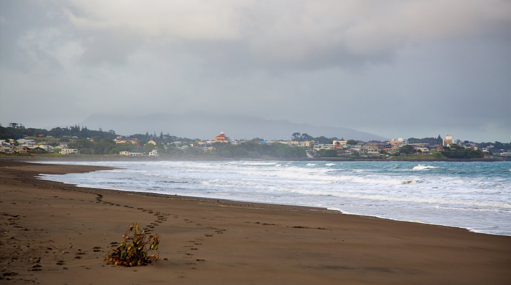 Fitzroy Beach showing a coastal town, surf and a bay or harbour