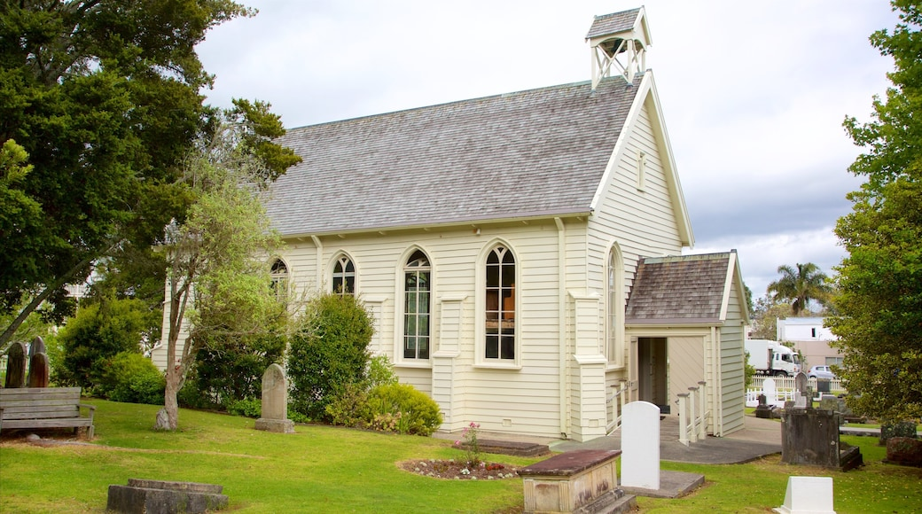 Russell Christ Church showing a church or cathedral and a cemetery