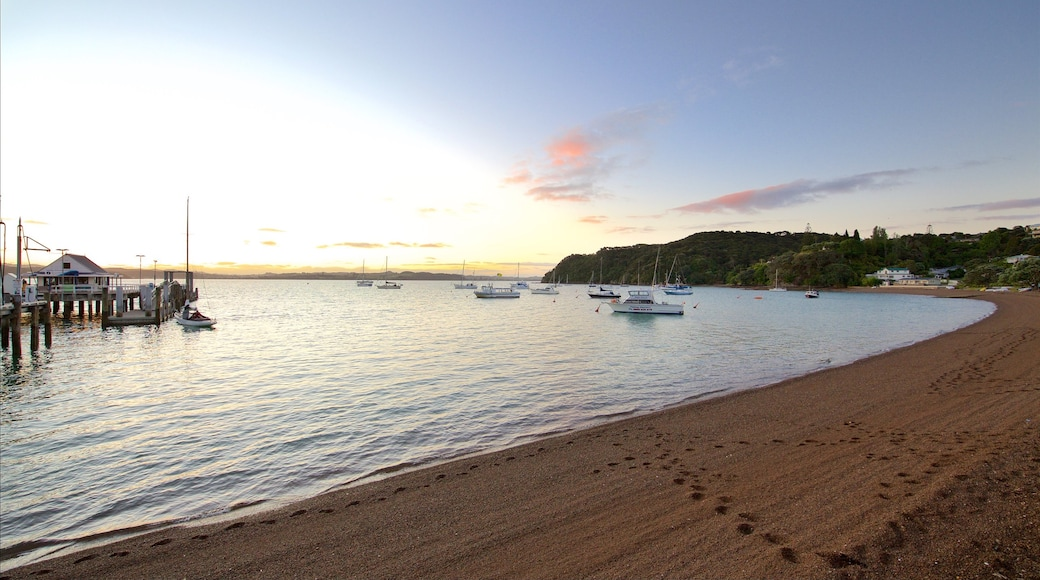 Russell Beach which includes a bay or harbour, a sunset and a pebble beach
