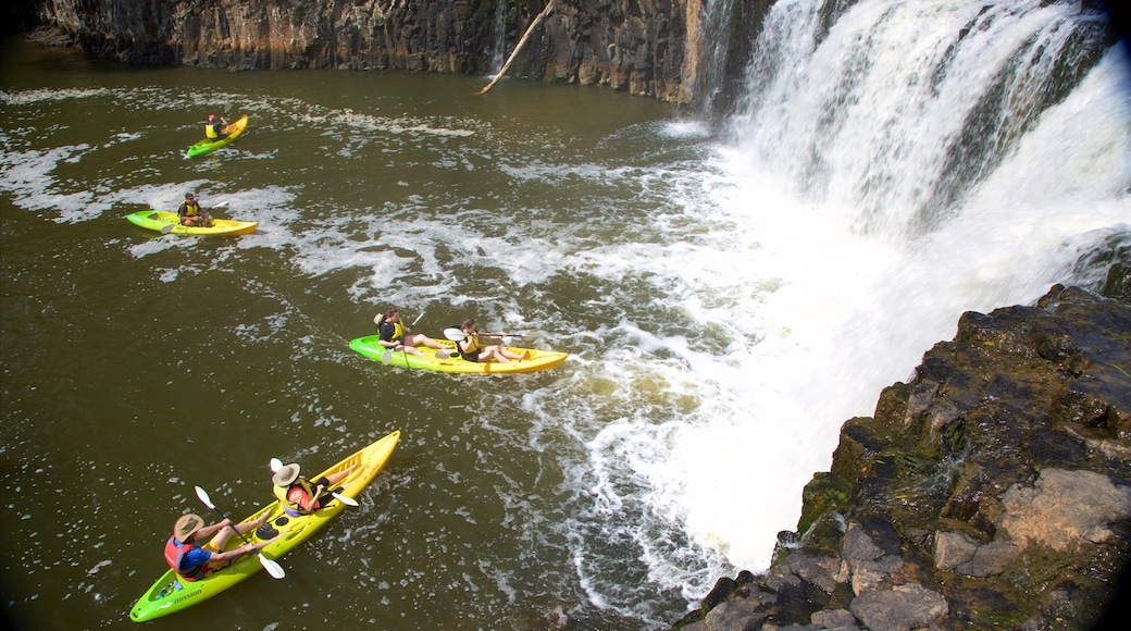 Haruru Falls which includes a waterfall, a river or creek and kayaking or canoeing