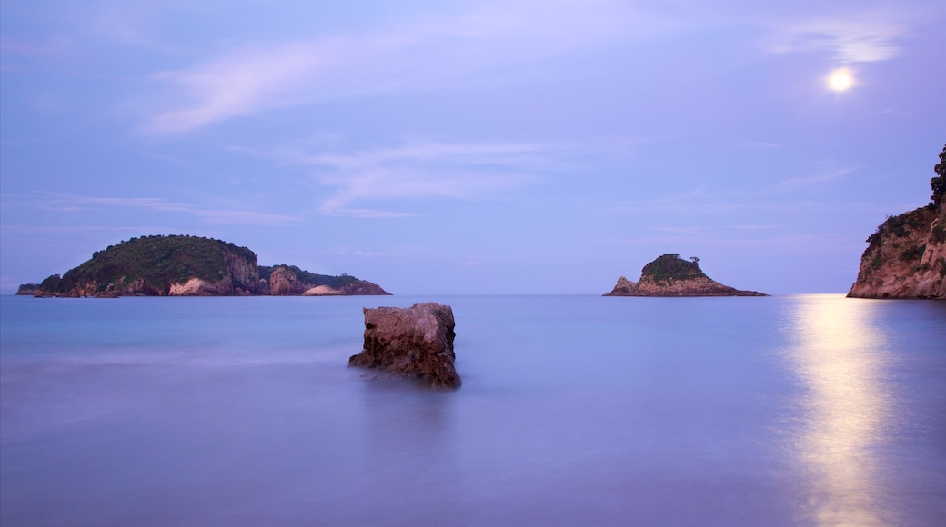 Hahei Beach which includes a sunset, a bay or harbour and island images