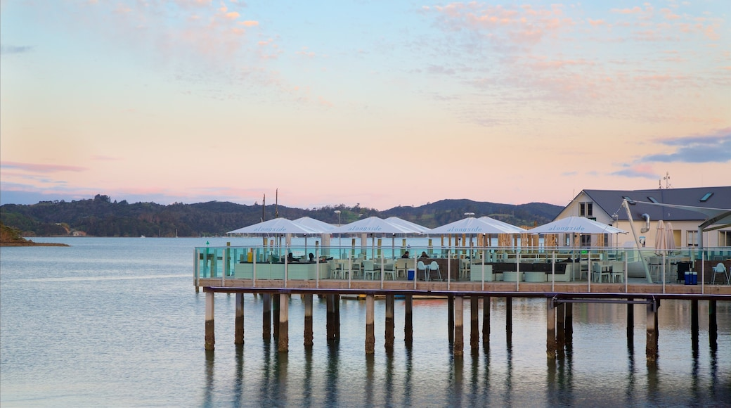 Paihia Wharf featuring a sunset, a bay or harbour and café lifestyle