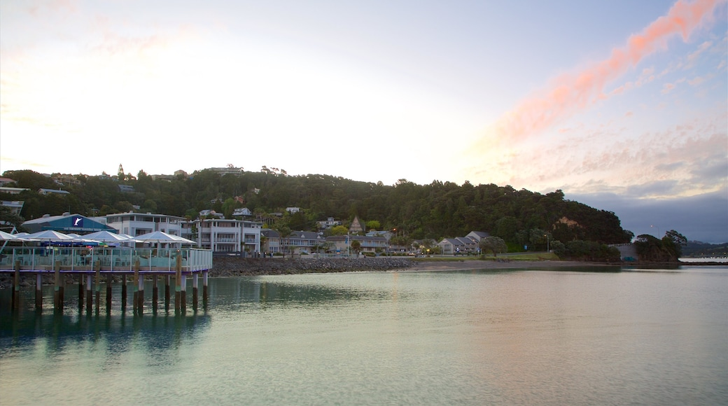 Paihia Wharf showing a coastal town, a sunset and a bay or harbour