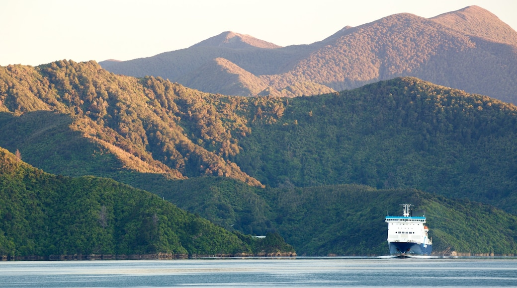 Picton featuring cruising, mountains and a sunset
