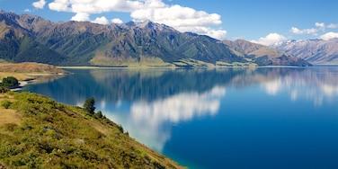 Lake Hawea featuring mountains and a lake or waterhole