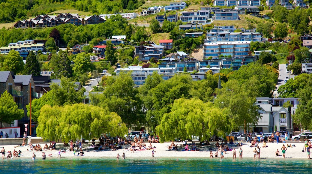 Queenstown Beach which includes a small town or village and a lake or waterhole