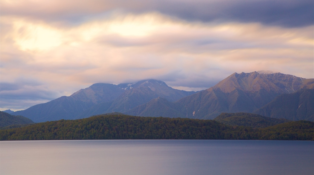 Lake Te Anau which includes mountains, a lake or waterhole and a sunset