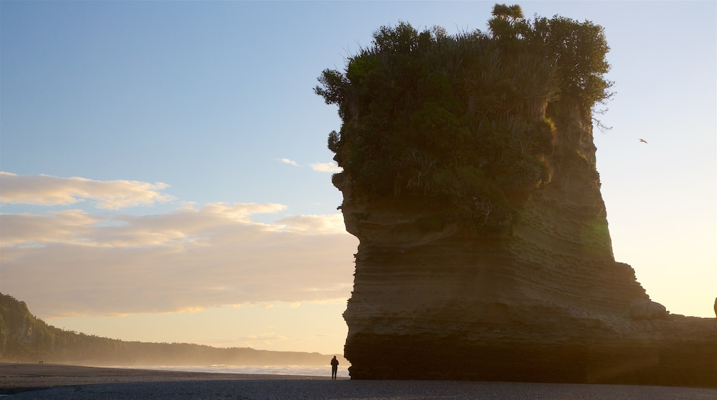 Punakaiki featuring mist or fog, rugged coastline and a sunset