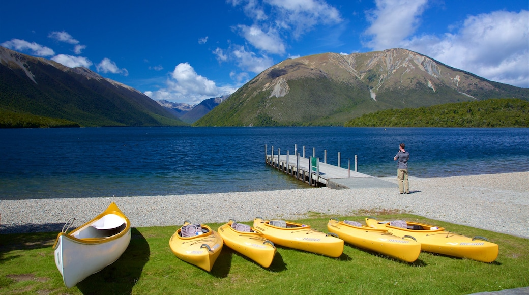 Nelson Lakes National Park featuring a bay or harbour, kayaking or canoeing and mountains