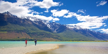 Glenorchy which includes mountains, a pebble beach and forests