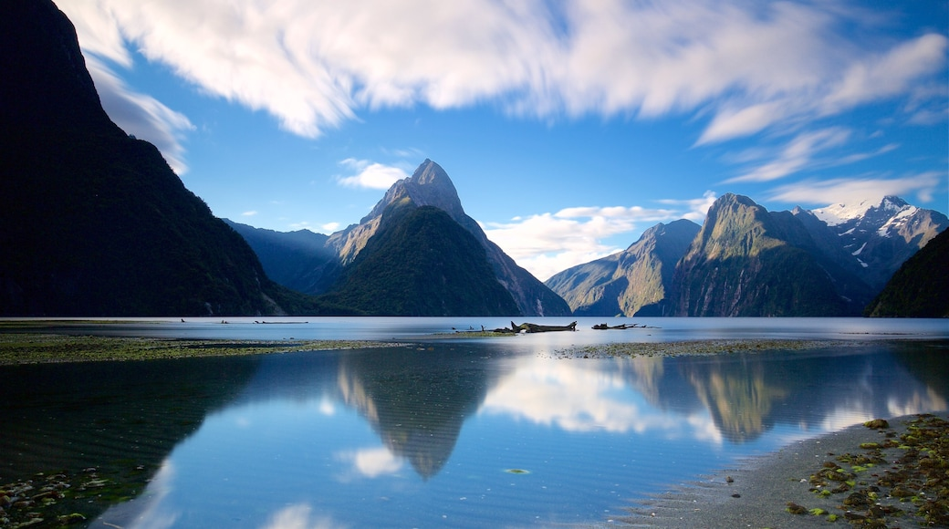 Mitre Peak which includes a lake or waterhole and mountains
