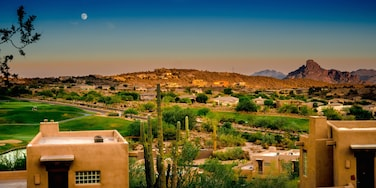 Fountain Hills showing a sunset, a small town or village and desert views
