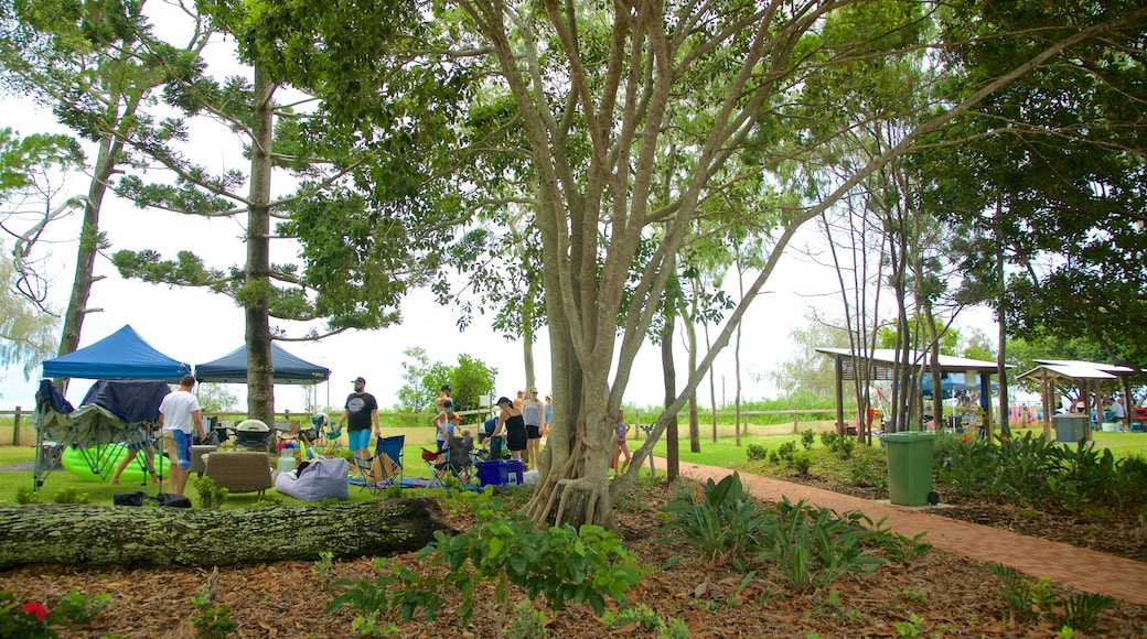 Esplanade which includes a garden and camping as well as a small group of people