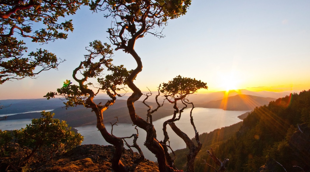 Salt Spring Island which includes mountains, a lake or waterhole and a sunset
