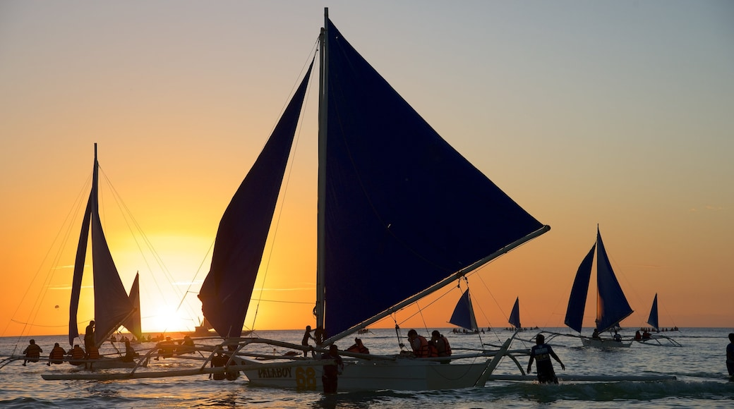 Boracay Island which includes a sunset, sailing and general coastal views