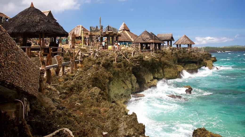 크리스탈코브 섬 을 특징 럭셔리 호텔 또는 리조트, 아열대 풍경 과 암석 해안선