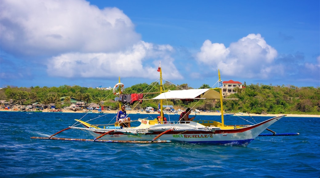 Boracay Island which includes island images, boating and tropical scenes