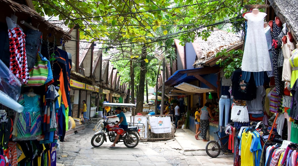 Talipapa Market showing markets and cycling as well as an individual male