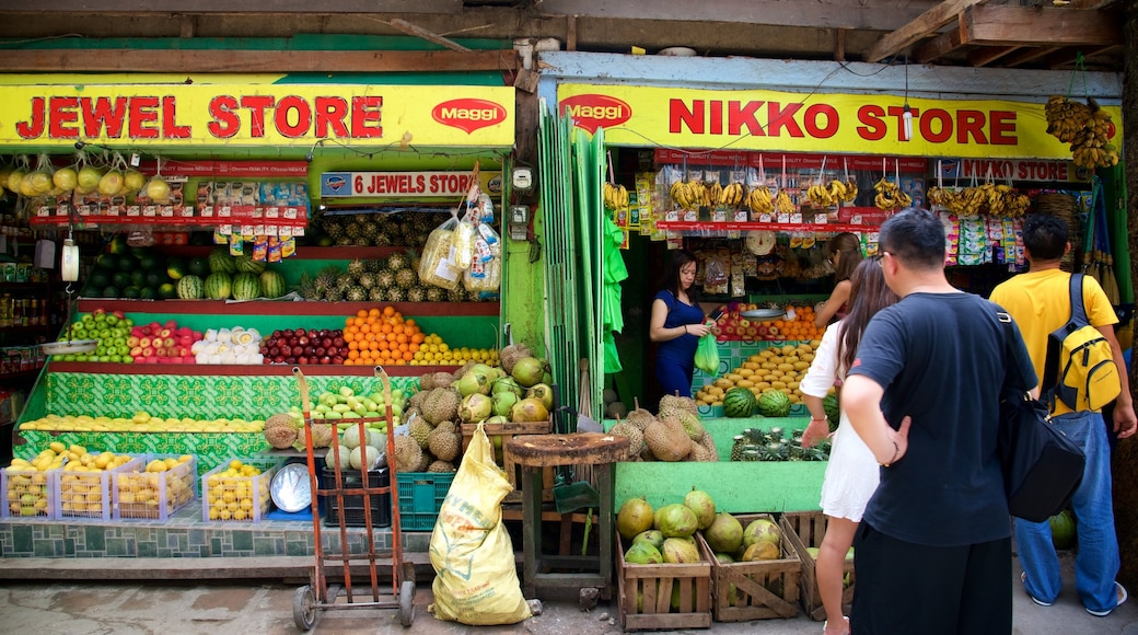 Talipapa Market which includes food, markets and signage