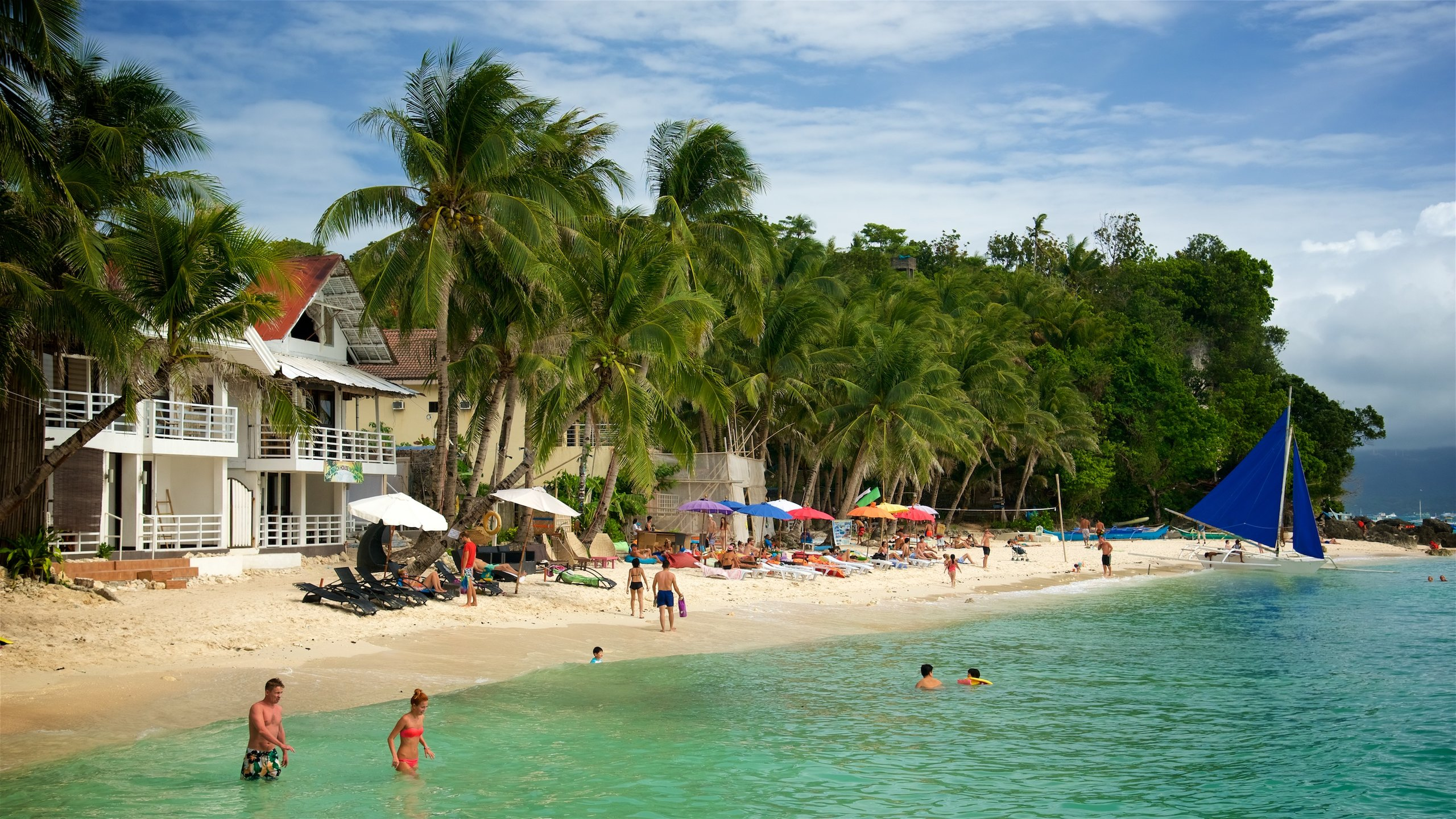Sink into crystalline water while basking in the scenic beauty at one of the more serene beaches on Boracay island.
