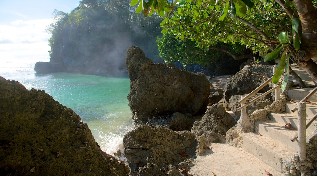 Balinghai Beach showing rocky coastline, tropical scenes and a bay or harbor