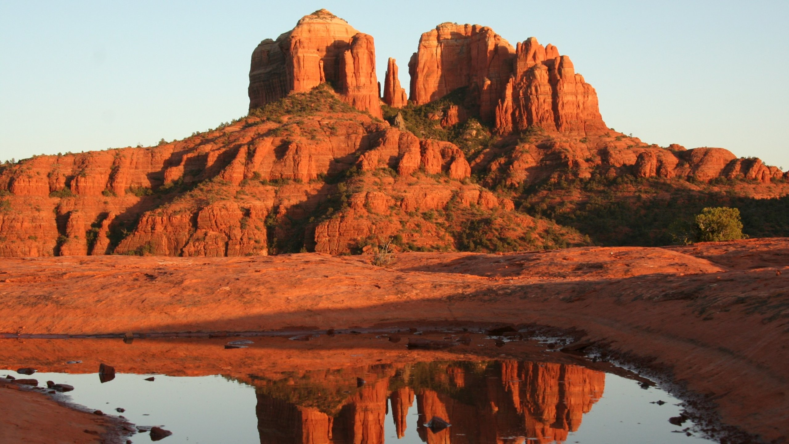 Sedona's skyline is distinctive for this crimson-hued sandstone formation, which stands like a giant sacred monument overlooking the red-rock landscape.