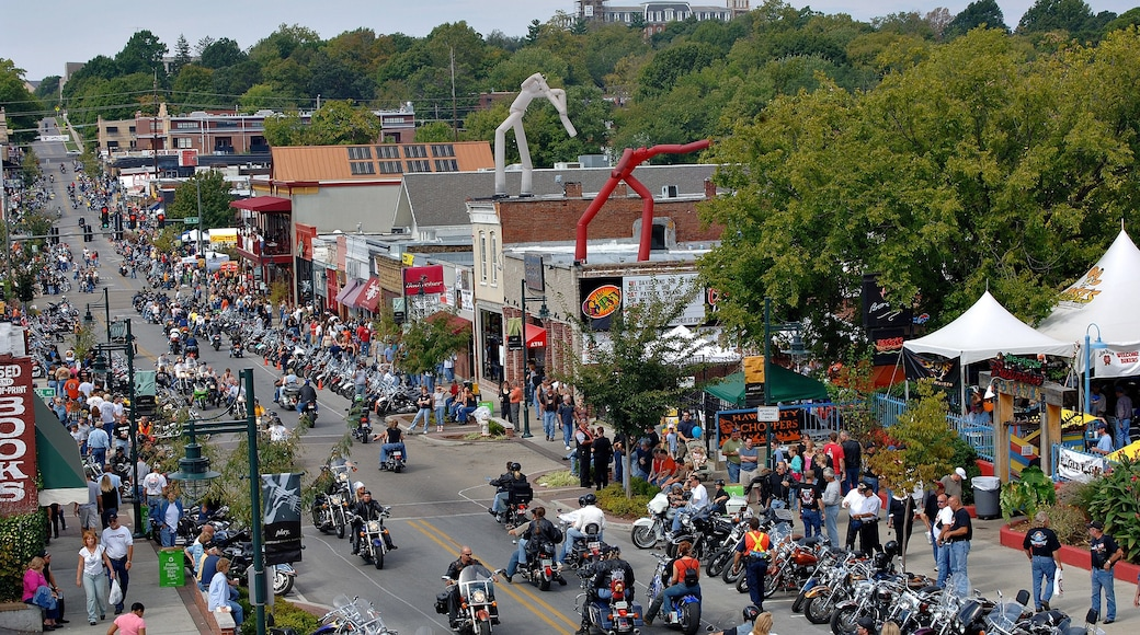 Fayetteville showing motorbike riding and street scenes as well as a large group of people