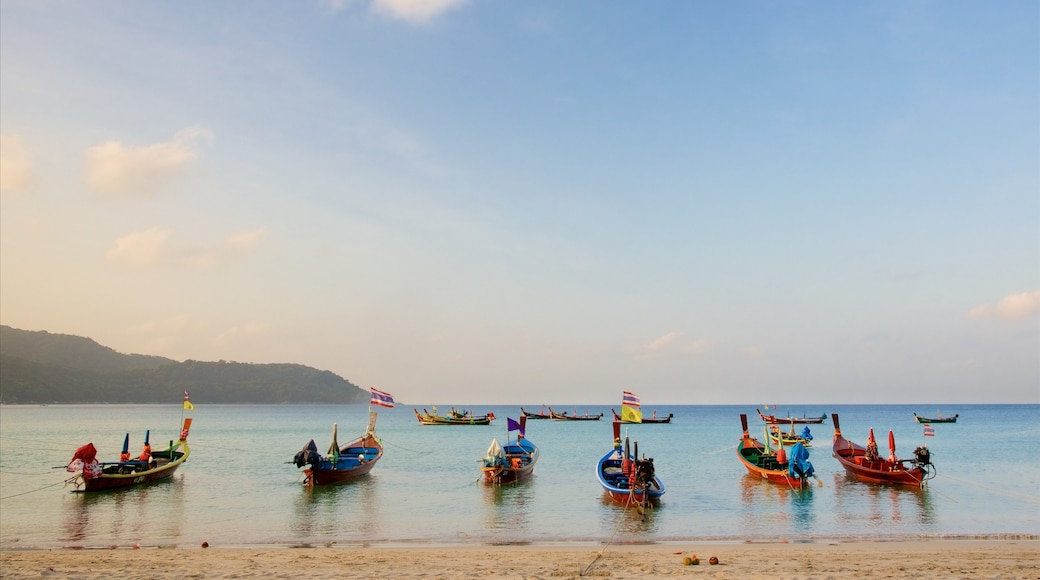 Kata Beach which includes a sunset, a bay or harbour and boating