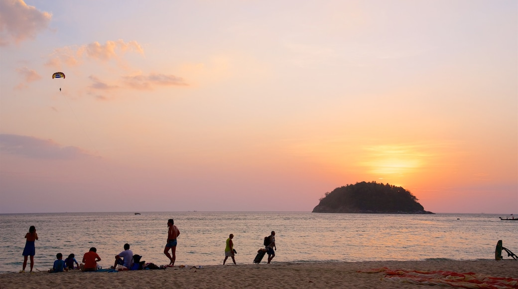 Kata Beach featuring a beach, a sunset and a bay or harbour
