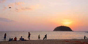 Kata Beach showing a bay or harbour, a sunset and a sandy beach