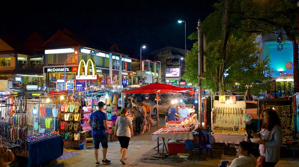 Chiang Mai Night Bazaar which includes markets, night scenes and street scenes