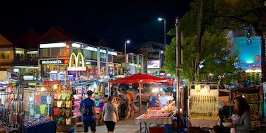 Chiang Mai Night Bazaar showing street scenes, signage and night scenes