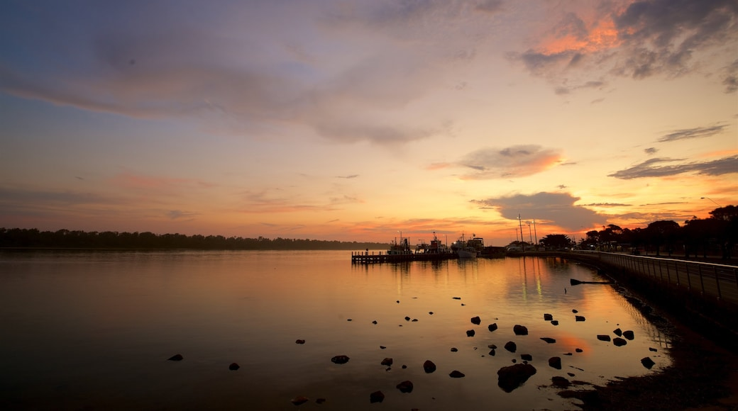 Lakes Entrance showing a sunset, a bay or harbour and a marina