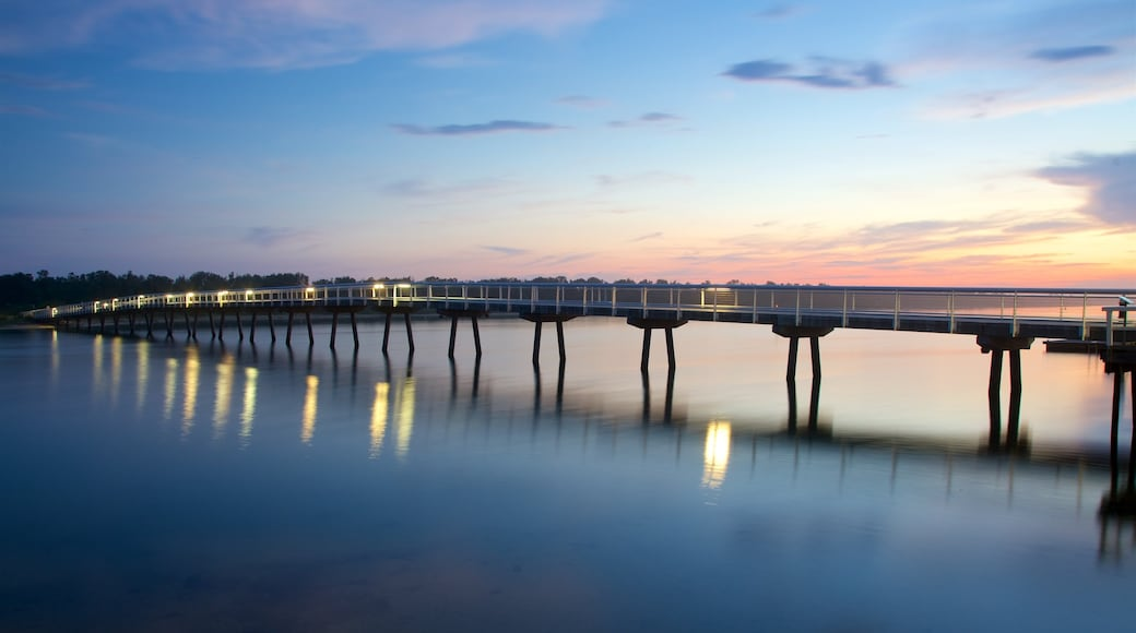 Lakes Entrance showing a bridge, a bay or harbour and a sunset