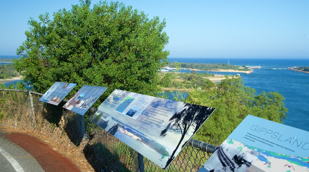 Lakes Entrance Lookout showing a bay or harbour and signage