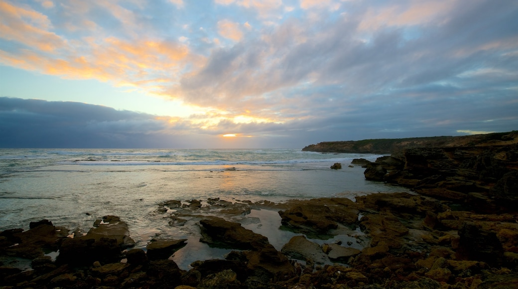 Warrnambool which includes a bay or harbor, a sunset and rocky coastline