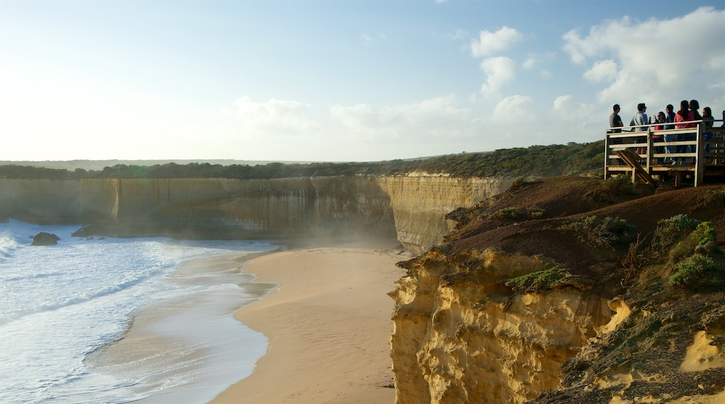 Port Campbell which includes a beach and views as well as a large group of people